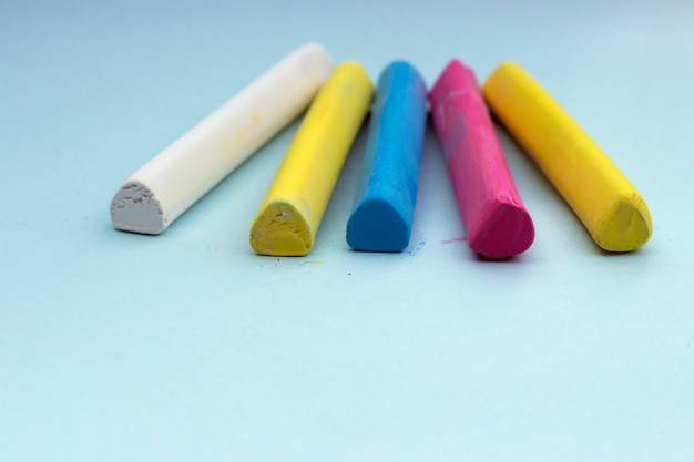 Multicolored crayons on a blue background, isolated