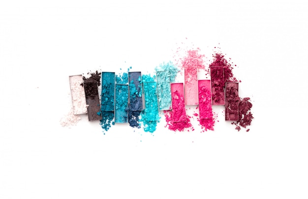 Multicolored crushed eyeshadows with brush isolated on white