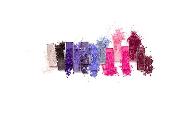 Multicolored crushed eyeshadows with brush isolated on white