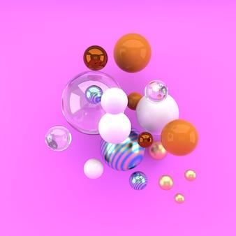 Разноцветные декоративные шары на розовой поверхности
