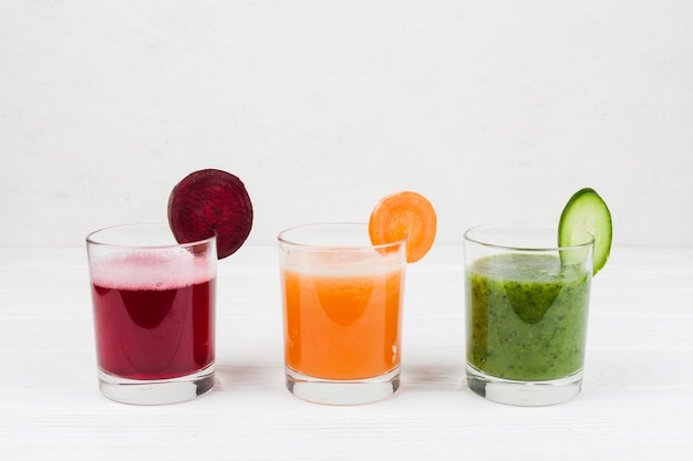 Multicolored drinks in glasses