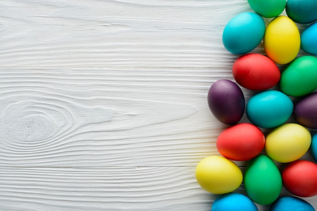 Multicolored easter eggs on the wood table.
