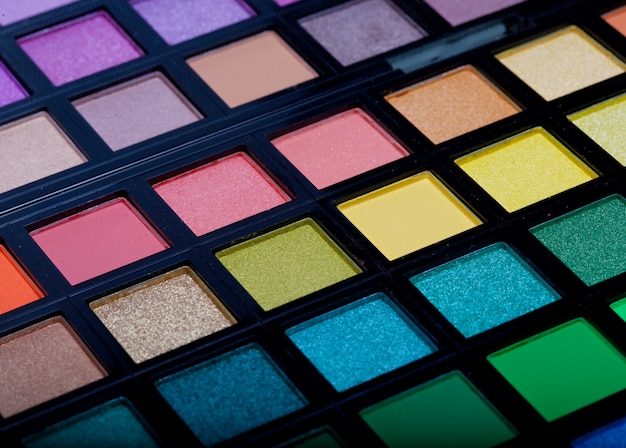 Multicolored eye shadows close up