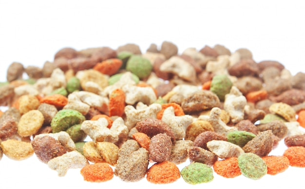 Multicolored food for cats and dogs. on a white wall.