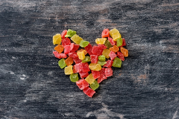 Multicolored fruit candied in shape of heart