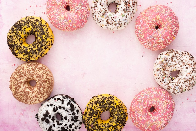 Multicolored glazed doughnuts with colorful sprinkles