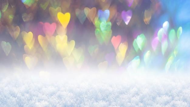 白い雪の上の色とりどりのハート、バレンタインデーおめでとうございます
