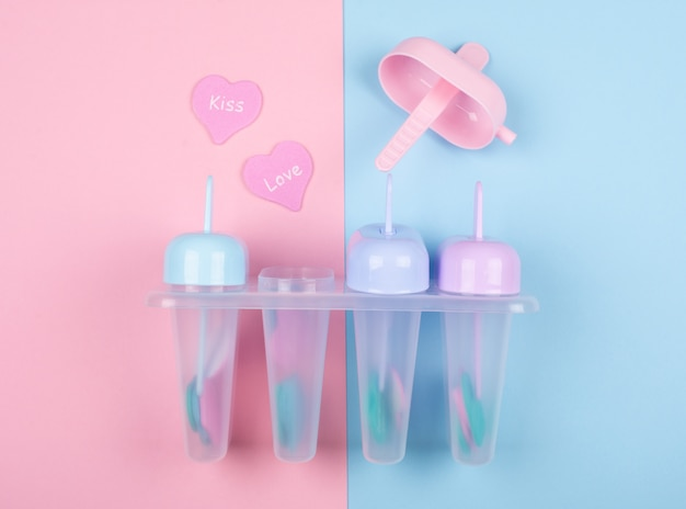 Multicolored ice cream moulds and paper hearts