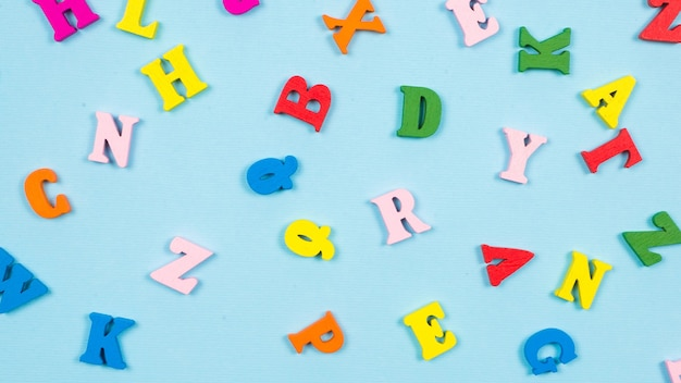 Multicolored letters on a blue background.