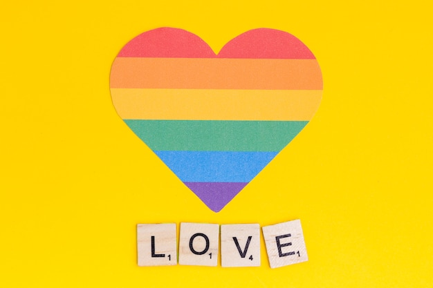 Multicolored lgbt heart with love lettering