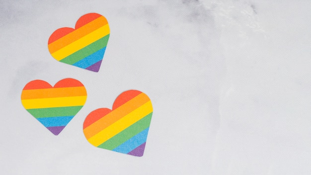 Multicolored lgbt hearts on white background