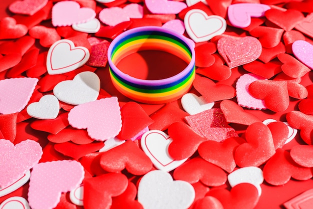 Multicolored lgbt symbol with romantic red hearts, valentines for same-sex couples.