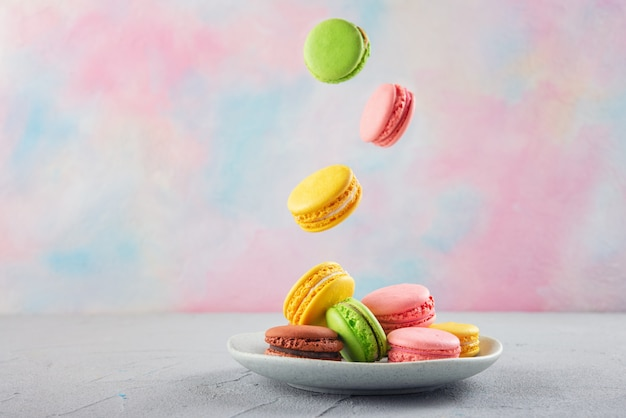 Multicolored macaroni cookies on a plate
