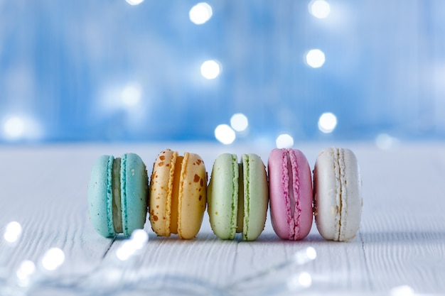 Multicolored macaroons on a surface of light bulbs