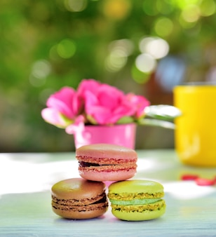 Multicolored macaroons on a white wooden table