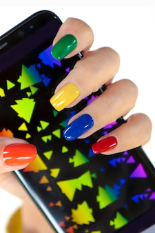 Multicolored manicure on nails of different shapes