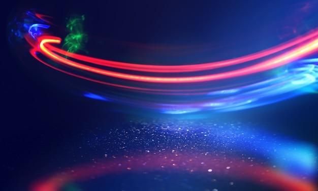 어두운 추상적 인 배경에 여러 가지 빛깔의 네온 모양