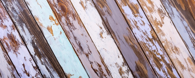 Multicolored old wooden plank background. diagonal stripes.