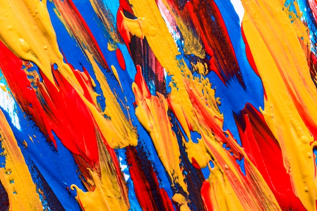 Multicolored paint brush strokes on surface
