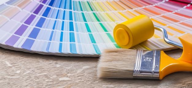 Multicolored pantone fan paint brush roller construction concept