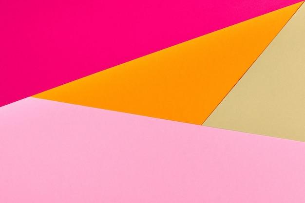 Разноцветный бумажный фон. абстрактная красочная бумажная текстура, космос экземпляра. яркие цвета для дизайна геометрического фона. цветной бланк для презентаций.