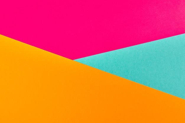 여러 가지 빛깔된 종이 배경. 추상 다채로운 종이 질감, 복사 공간. 디자인 기하학적 배경을 위한 밝은 색상. 프리젠테이션의 경우 색상이 비어 있습니다.