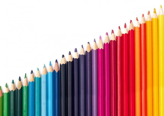 Multicolored pencils in a row by color temperature on a white background isolate, flat lay
