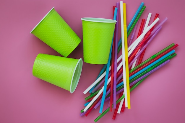 Multicolored plastic cups and straws