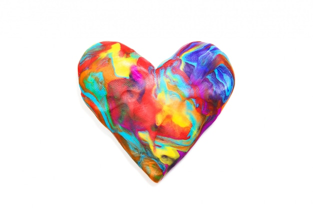 Multicolored plasticine heart on white background. isolated on white. texture of plasticine