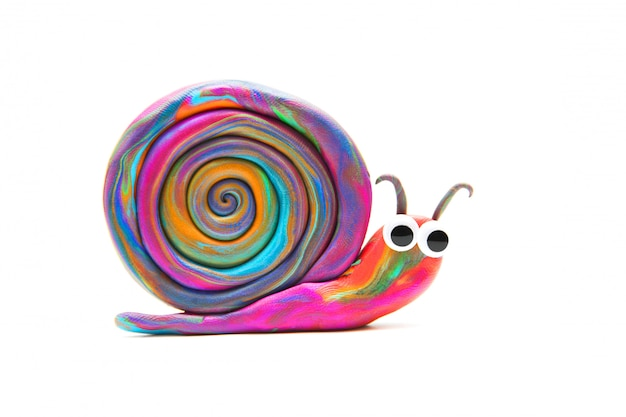 Multicolored plasticine snail on white background. isolated on white. plasticine modeling