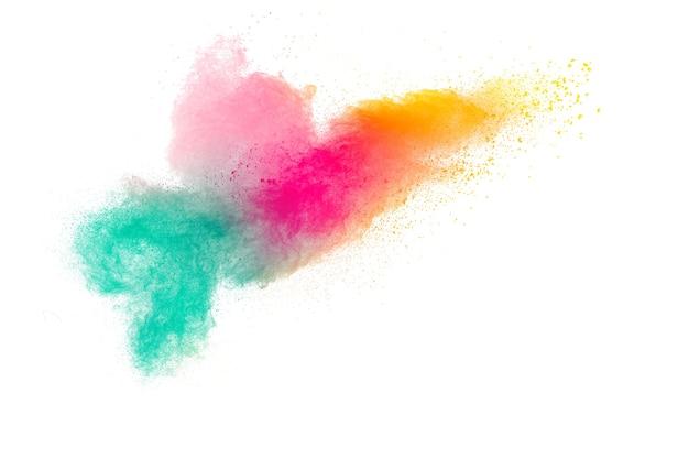 Взрыв разноцветного порошка на белом фоне.