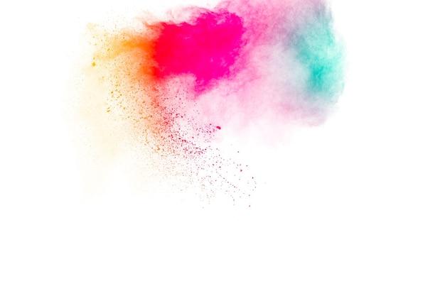 Multicolored powder explosion on white