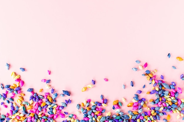 Multicolored seashells background on pink, top view, copy space. summer concept