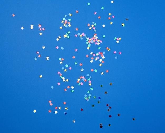 Multicolored shiny confetti in the form of stars