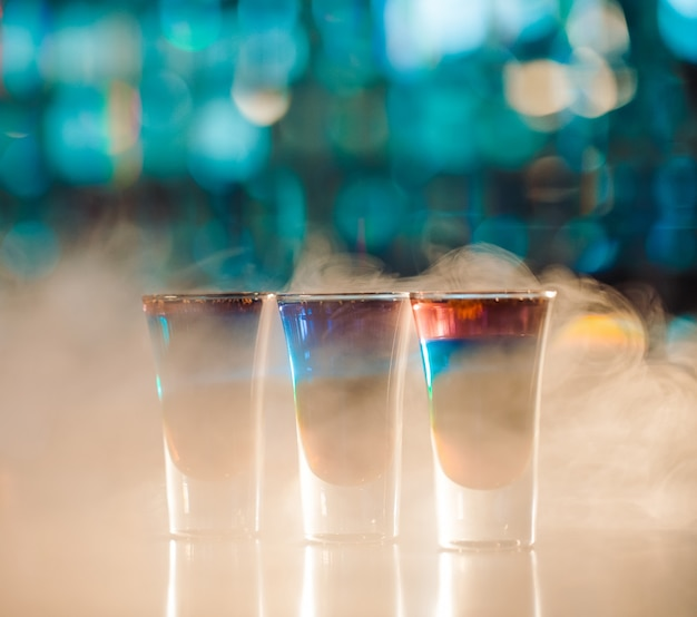 Multicolored shots on the bar