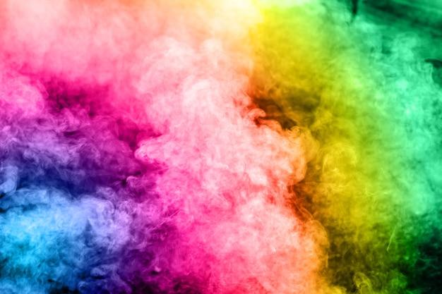 Multicolored smoke on background.