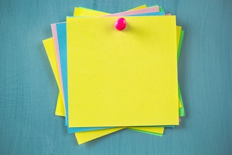 Multicolored sticky empty notes on the bulletin board