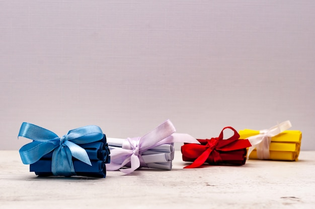 Multicolored stop tickets, tied with a gift bow. creativity and creativity.