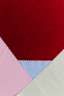 Multicolored striped fabric on burgundy background