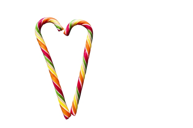 Multicolored striped heart-shaped lollipops on a white background. christmas, new year,