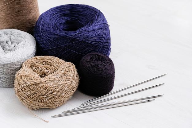 Multicolored threads of italian wool yarn, spokes.