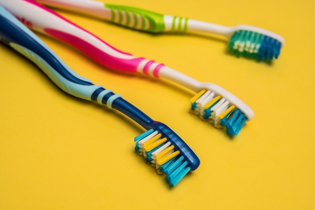 Multicolored toothbrushes copy space yello