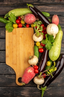 Multicolored vegetables fresh ripe a top view on a rustic