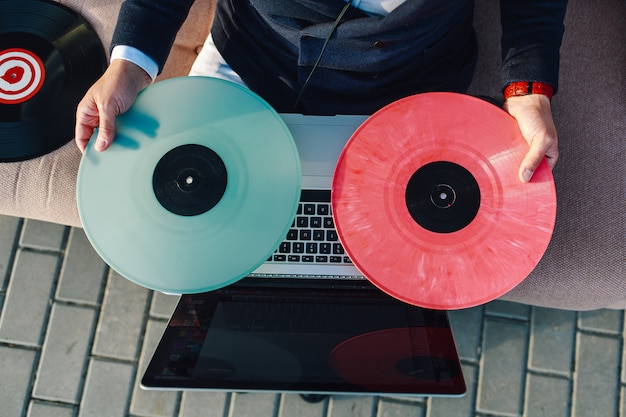 Multicolored vinyl records on a laptop