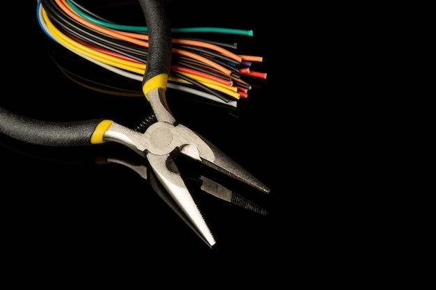 Multicolored wires and round nose pliers