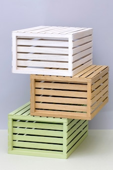Multicolored wooden boxes on a colored background
