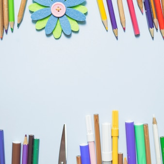 Multicolored writing implements with origami flower