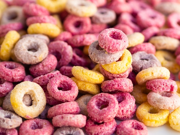 Multicoloured cereals with fruity close-up