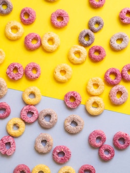 Multicoloured cereals with fruity on contrasted background