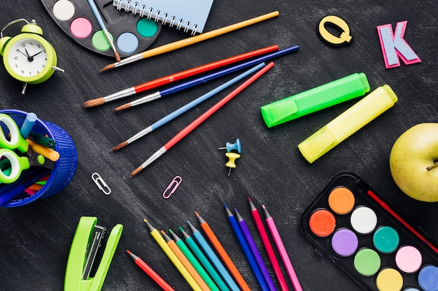 Multicoloured messy stationery on grey background